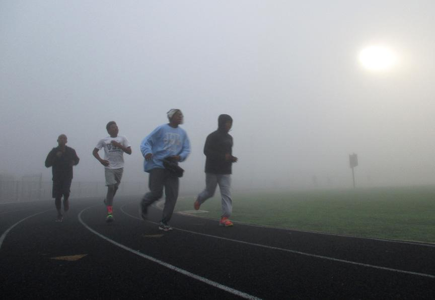Red+Oak+Middle+School+track+athletes+Zion+Blair%2C+from+left%2C+Zach+Sanders%2C+Walter+Taylor%2C+Alfred+%27Trey%27+Lintz+run+laps+to+warm+up+for+track+practice+Feb.+29.+