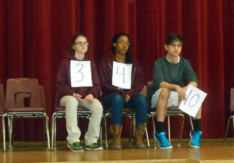 Natalie Bonneau, Dariana Burton and Jett Grayson wait for their next word during the spelling bee on Jan. 16. They were the final three spellers, with Grayson emerging as the winner and Bonneau the alternate.