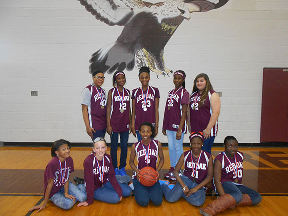The 7th grade B-team girls won 1st place in the district tournament.