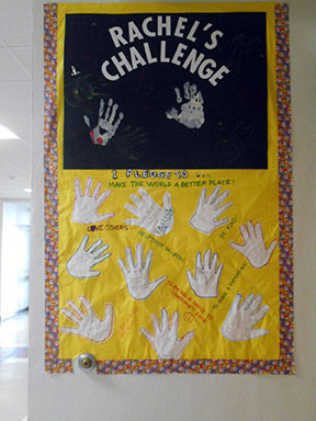 Handprints showing students' commitment to Rachel's Challenge are displayed in the ROJH hallway.