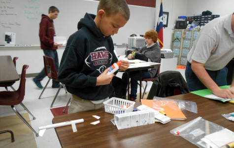 Student Ty Souder works on buliding his rocket for a project in Civil Air Portal.