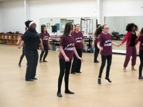 At the Red Oak  Junior High dance gym, the dance team practices for their performance at the basketball game.