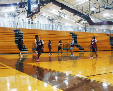 The 7th grade girls basketball team practice in the ROJH gym for an upcoming game. Coach Paige Patterson has been instructing the girls on how to improve their game.