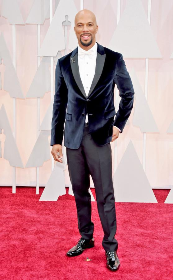 Even though rapper Common won an Oscar, his outfit wasn't the best looking of the night. Common's Prada suit was interesting, but the suede suit jacket didn't go with his pants at all.