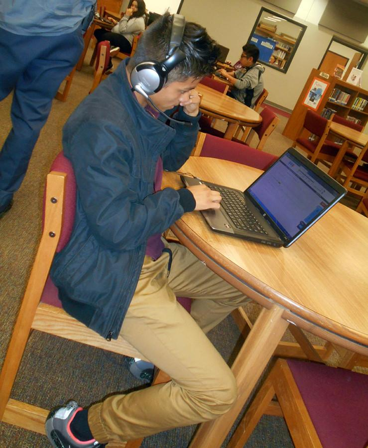 Guillermo Flores stays comfortable in his joggers as he works on Think Through Math in the ROJH library Monday.