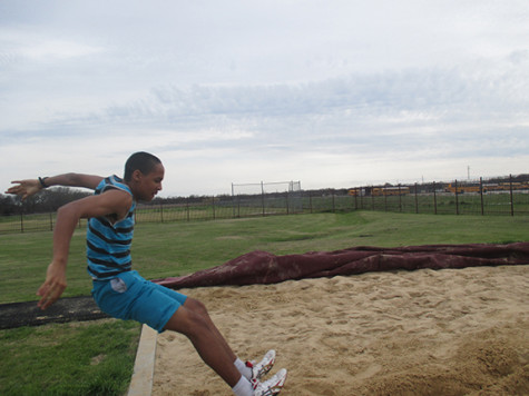 Brandon Swift practices long jump for the first track meet