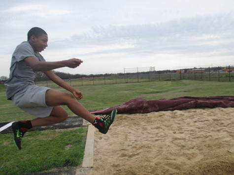 Kavaruas Tennyson practices long jump to see how far he gets