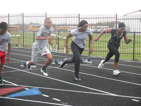 Marcus Badget, Derrick Smith, Keniah McGruffin, and Aliyah Harden race in practice