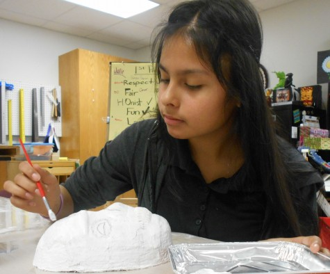 Jeanette Rameros starts her mask for the understand of the cultural customs.