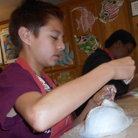 Jose Flores works on his tribal mask during Malea Jaffe's art class. The project is meant to help students understand tribal customs.