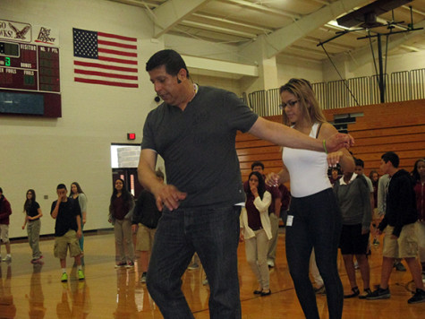 Luis Delgadillo and Tara directs Mrs. Issacks and Mr. smith's classes on how to salsa.