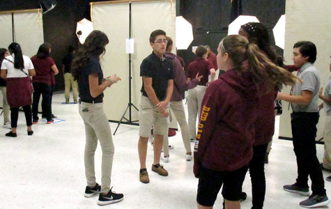Diego Ponce-Jimenez, center, and other students wait to have their photos taken during picture day in the theater room at Red Oak Middle School, Wednesday, Sept. 23.