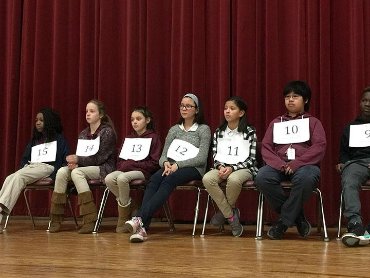 Competitors wait to be called to the mic at the ROMS spelling bee, which took place Jan. 12 in the ROMS cafeteria. More than 30 students in grades 6-8 signed up to complete