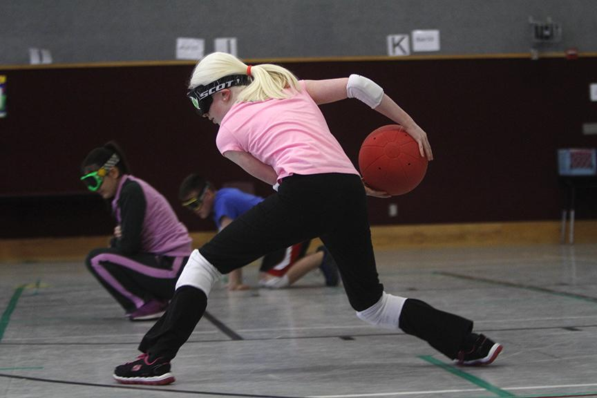 Paulina Diaz serves the ball against the opposing goalball players during practice Saturday, Feb. 13, 2016. Goalball is a sport designed for the blind and visually impaired, in which they must listen for the sound of the ball and block it with their bodies. The Red Oak team practices every other Saturday at Schupmann Elementary.