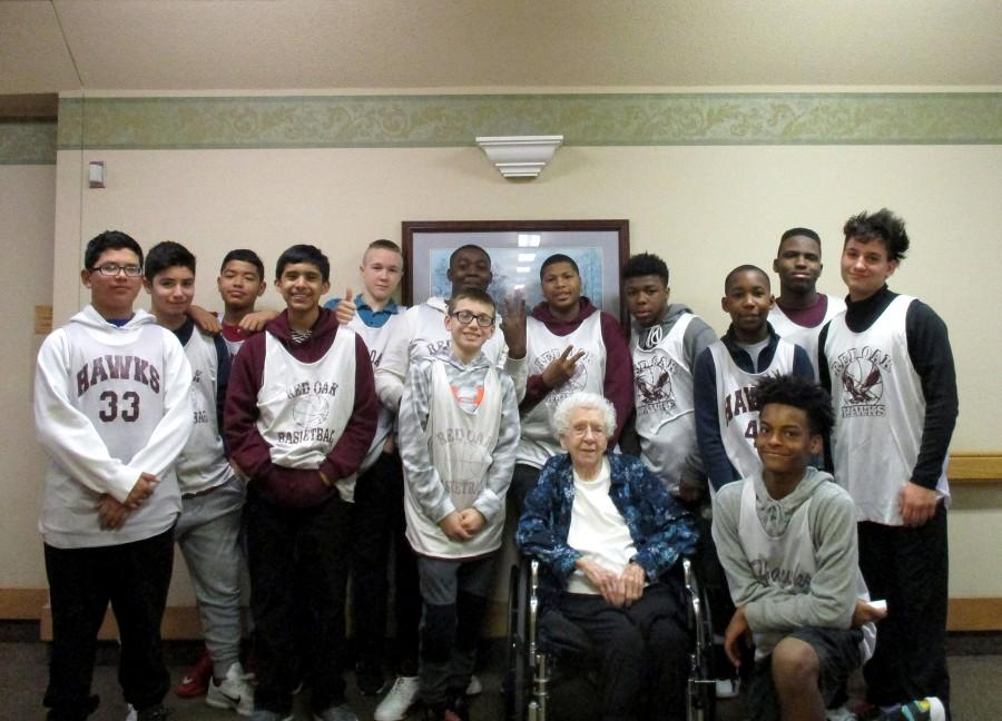 On a recent visit by the Red Oak Middle School boys basketball team to Red Oak Health & Rehabilitation Center, 96-year-old Mary Rowlette just wanted a picture of the team. Instead of making themselves the center of attention, they made Mary the focus, placing her in the middle as they circled around her for the photo.