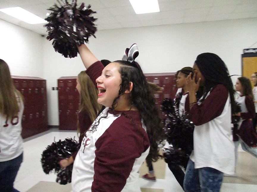 Red Oak Middle School cheerleader Melanie Soto shows her enthusiasm during a send-off parade for the schools Destination Imagination team, which is headed to the state tournament in Anna, TX  on April 1.  School administrators planned the surprise send-off for team members Abby Anderson, Camille Condron, Heather Fellows, Laney Fleming, Connor Nunley and Colton Perdue.