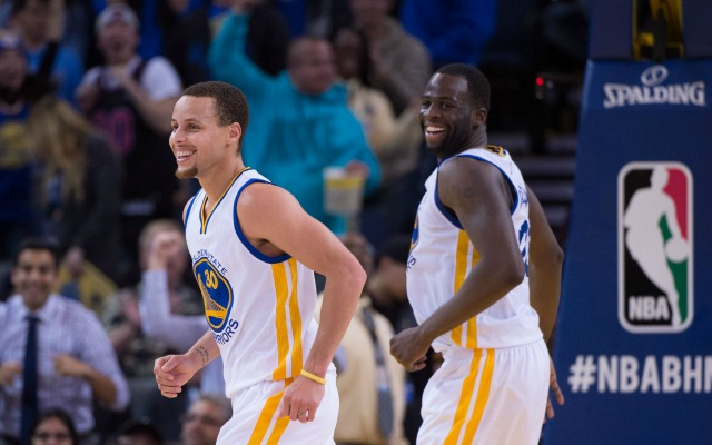 February 4, 2015; Oakland, CA, USA; Golden State Warriors guard Stephen Curry (30) and forward Draymond Green (23) celebrate during the fourth quarter against the Dallas Mavericks at Oracle Arena. The Warriors defeated the Mavericks 128-114. Mandatory Credit: Kyle Terada-USA TODAY Sports