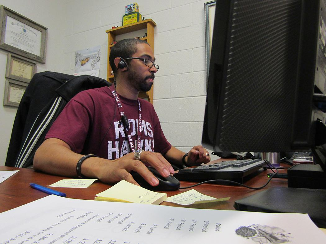 Assistant Principal Andre Ford, already donning Red Oak maroon and white, has a rare opportunity to sit down in his office to handle paperwork.  Since starting his new assignment, Ford has constantly been on the move, interacting with students and staff at the main building and the sixth grade center.