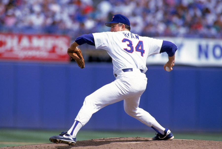 ARLINGTON, TX:  Nolan Ryan #34 of the Texas Rangers pitches during a game at Arlington Stadium in Arlington, Texas.  Ryan pitched for the Rangers from 1989-93.  (Photo by Rich Pilling/MLB Photos via Getty Images)