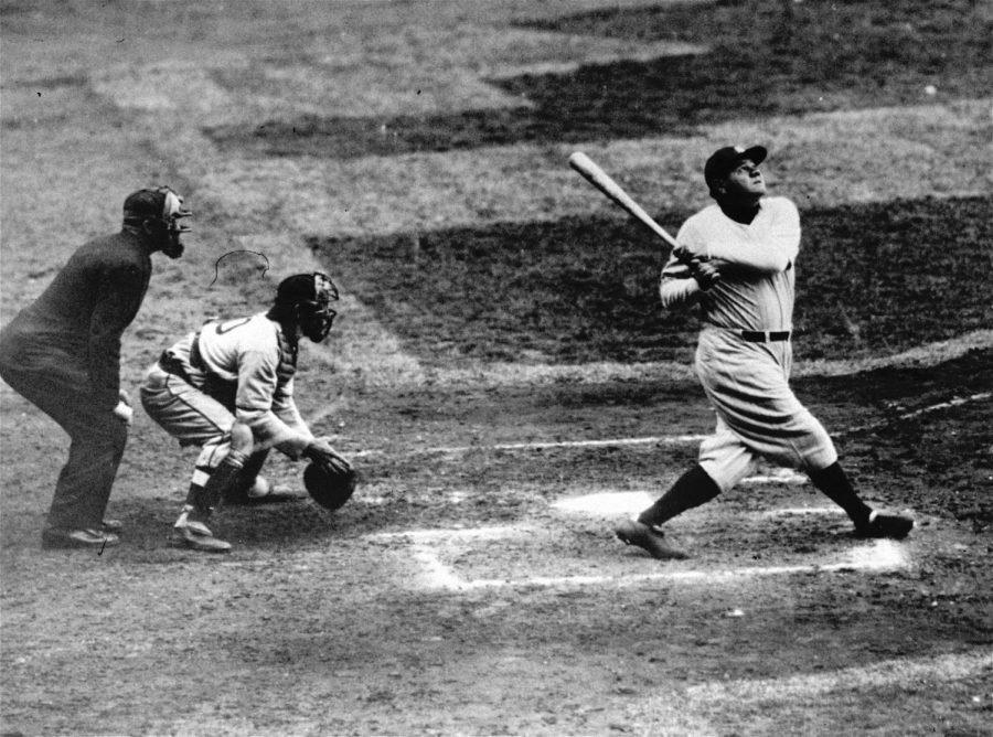 ** FILE ** Babe Ruth of the New York Yankees hits a home run in this undated photo. San Francisco Giants' Barry Bonds has always shown a knack for hitting his most special home runs at home. Now, he will try to move past Babe Ruth's 714 home run record in the sparkling waterfront ballpark he knows best. (AP Photo)